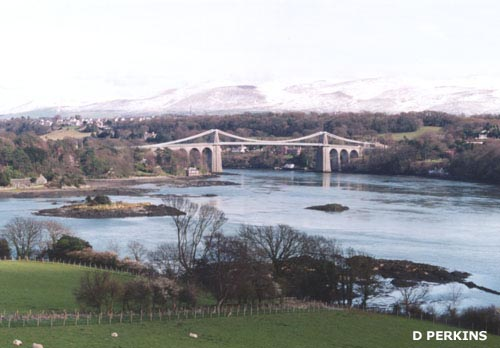The Menai Suspension Bridge with winter snow on the Snowdonia Mountains.Photo: © D. Perkins.