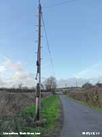 Overhead fibre optic cable in Llansadwrn.